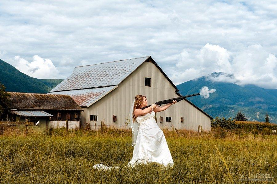 wedding shooting guns in front of barn