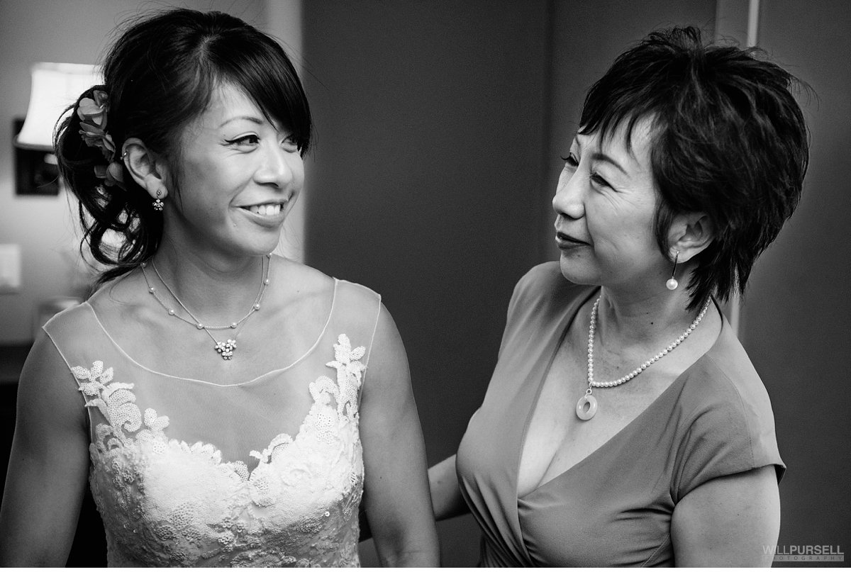 candid wedding moment mom and bride