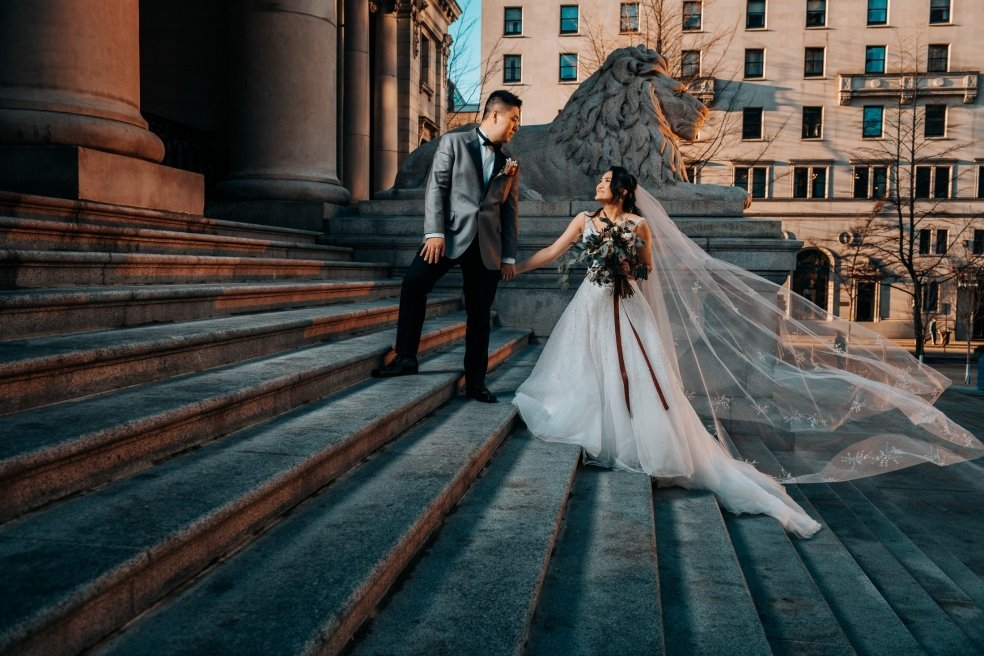 Wedding photo on stairs of Vancouver Art Gallery